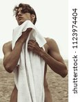 sexy beautiful striped male... | Shutterstock . vector #1123974404