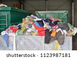 Used Clothes At Recycling...