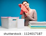 feel softness. smiling woman... | Shutterstock . vector #1124017187