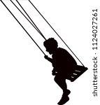 a boy on swing  silhouette... | Shutterstock .eps vector #1124027261