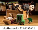 children toys in a wooden box ... | Shutterstock . vector #1124051651