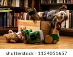 children toys in a wooden box ... | Shutterstock . vector #1124051657