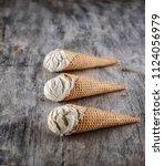 vanilla ice cream with cone on...   Shutterstock . vector #1124056979