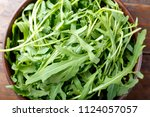 fresh rucola salad chopped on a ... | Shutterstock . vector #1124057057