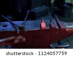 hot steel parts and forge tongs ... | Shutterstock . vector #1124057759