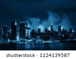 Fireworks show with Manhattan midtown skyscrapers and New York City skyline at night - stock photo