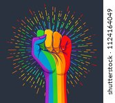 rainbow colored hand with a... | Shutterstock .eps vector #1124164049