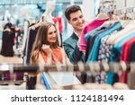 happy couple shopping for...   Shutterstock . vector #1124181494