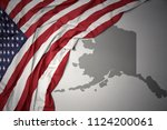 waving colorful national flag... | Shutterstock . vector #1124200061