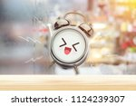 the alarm clock is happy in the ... | Shutterstock . vector #1124239307