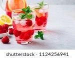 refreshing summer cocktail.... | Shutterstock . vector #1124256941