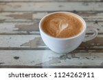 hot coffee with frothy foam in... | Shutterstock . vector #1124262911