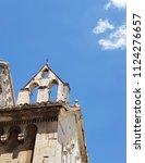 a belfry under the blue sky   Shutterstock . vector #1124276657