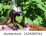 homemade syrup from the black...   Shutterstock . vector #1124283761