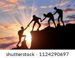 men climbers help each other in ... | Shutterstock . vector #1124290697