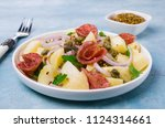 traditional potato salad with... | Shutterstock . vector #1124314661