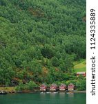 Small photo of Norwegian house beside the Fjord. Flam, Norway.15th June 2018. For editorial use only