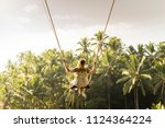 woman swinging in the jungle ... | Shutterstock . vector #1124364224