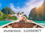 happy traveler asian woman... | Shutterstock . vector #1124365877
