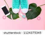 bright summer accessories on a... | Shutterstock . vector #1124375345