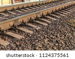 old railroad tracks in... | Shutterstock . vector #1124375561