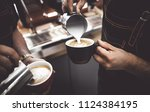 two baristas pouring milk into... | Shutterstock . vector #1124384195