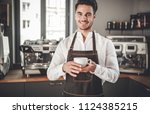 professional barista in apron... | Shutterstock . vector #1124385215