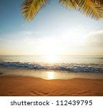 serene beach at sunset - stock photo