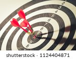 dart arrow hitting in the... | Shutterstock . vector #1124404871