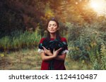 a beautiful dark haired... | Shutterstock . vector #1124410487