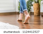 floor heating. young woman... | Shutterstock . vector #1124412527