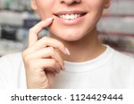 lip protection. closeup of... | Shutterstock . vector #1124429444