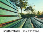 Close Up Of Green Wooden Bench...