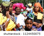 Small photo of AMSTERDAM,NETHERLANDS - JULY 1, 2018: People take part during Bigi Spikri celebration of the Reminding Abolition of Slavery Day on July 1, 2018 in Amsterdam,Netherlands.