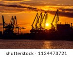 Colorful Sunset Over Sea Port...