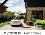 happy bride and groom arrived... | Shutterstock . vector #1124474327