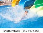 a happy toddler boy in the aqua ... | Shutterstock . vector #1124475551