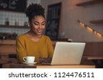 beautiful afro american girl in ... | Shutterstock . vector #1124476511