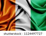 cote d'ivoire fabric flag... | Shutterstock . vector #1124497727