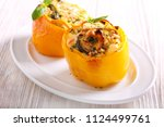stuffed yellow bell pepper with ... | Shutterstock . vector #1124499761