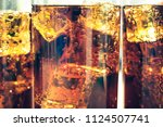 background of cola with ice and ... | Shutterstock . vector #1124507741