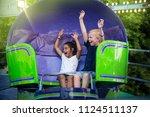 Two Screaming Kids Enjoying A...
