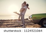 romantic couple is standing... | Shutterstock . vector #1124521064