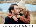 loving couple embracing in the... | Shutterstock . vector #1124541614