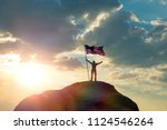 the man is standing on the top... | Shutterstock . vector #1124546264