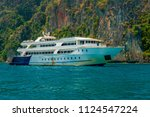 motor boat and island in the sea | Shutterstock . vector #1124547224