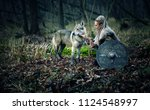 warrior woman with a woolf in... | Shutterstock . vector #1124548997