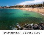 las americas beach adeje coast... | Shutterstock . vector #1124574197