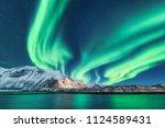 green northern lights in...   Shutterstock . vector #1124589431