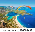paragliding in the sky.... | Shutterstock . vector #1124589437
